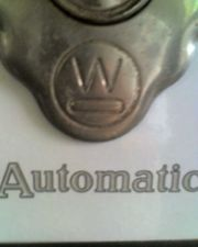 Close up of Westinhouse logo on historic kitchen stove at John & Mable Ringling Museum, Sarasota